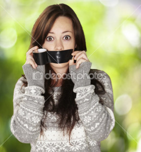 depositphotos_10181534-Portrait-of-scared-girl-being-silenced-by-herself-against-a-natu